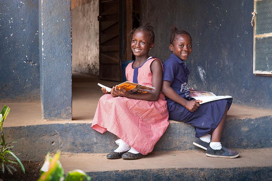 2 girls on a step in Sierra Leone